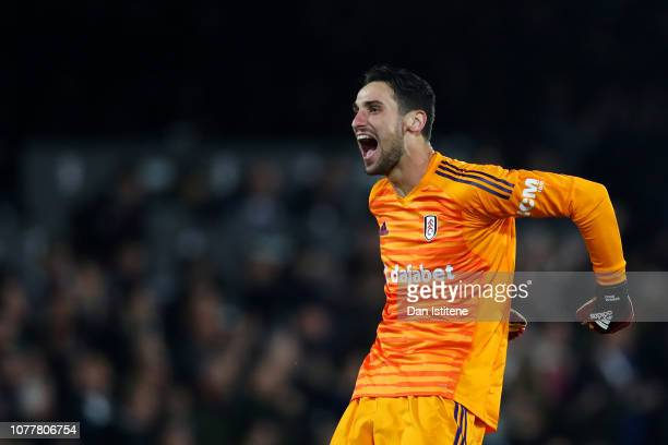 Sergio Rico of Fulham celebrates after his teammate Aboubakar Kamara scored during the Premier League match between Fulham FC and Leicester City at...