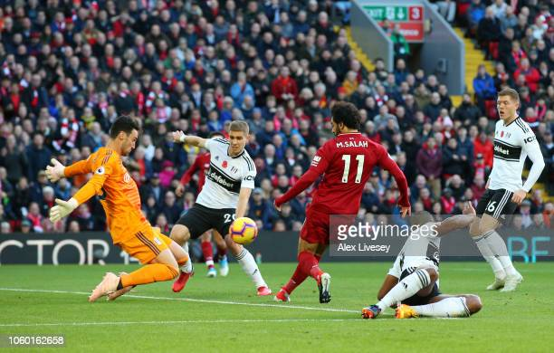 Sergio Rico of Fulham makes a save from Mohamed Salah of Liverpool during the Premier League match between Liverpool FC and Fulham FC at Anfield on...