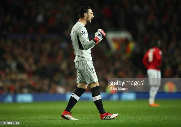 Sergio Rico of Sevilla celebrates during the UEFA Champions League Round of 16 Second Leg match between Manchester United and Sevilla FC at Old...