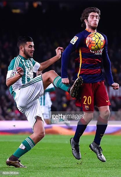 Sergio Roberto of FC Barcelona competes for the ball with Dani Ceballos of Real Betis Balompie during the La Liga match between FC Barcelona and Real...