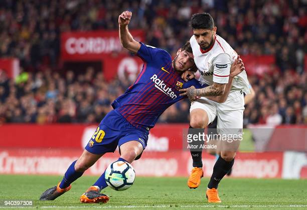 Sergio Roberto of FC Barcelona competes for the ball with Ever Banega of Sevilla FC during the La Liga match between Sevilla CF and FC Barcelona at...