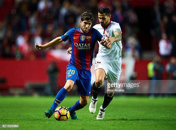 Sergio Roberto of FC Barcelona competes for the ball with Victor Machin Perez Vitolo of Sevilla FC during the match between Sevilla FC vs FC...