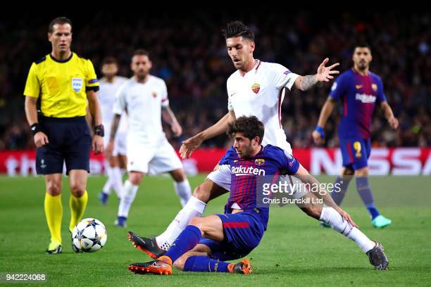 Sergio Roberto of FC Barcelona in action with of Lorenzo Pellegrini AS Roma during the UEFA Champions League Quarter Final first leg match between FC...