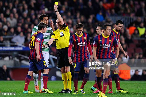 Sergio Roberto of FC Barcelona is shown a yellow card by the referee Sergei Karasev for a challenge on Virgil van Dijk of Celtic FC during the...