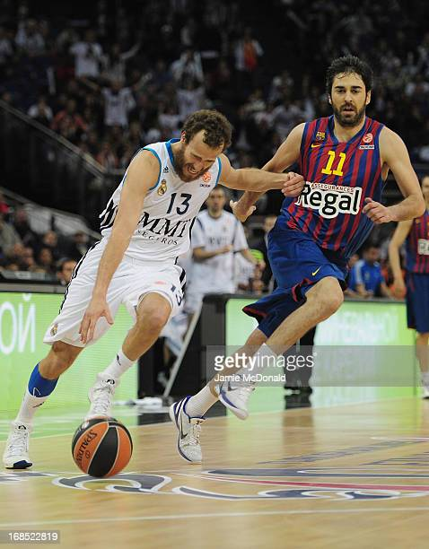 Sergio Rodriguez of Real Madrid tussles with Juan Carlos Navarro of FC Barcelona during the Turkish Airlines EuroLeague Final Four semi final game...