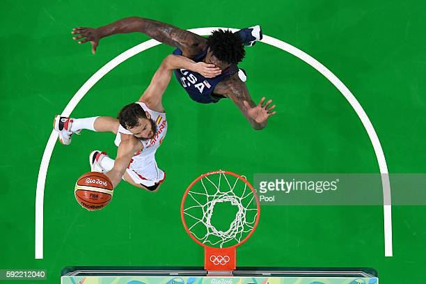 Sergio Rodriguez of Spain goes to the basket against DeAndre Jordan of United States during the Men's Semifinal match on Day 14 of the Rio 2016...