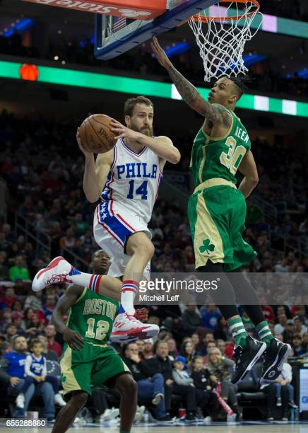 Sergio Rodriguez of the Philadelphia 76ers passes the ball against Gerald Green of the Boston Celtics in the fourth quarter at the Wells Fargo Center...