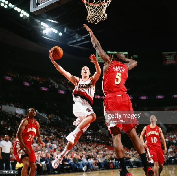 Sergio Rodriguez of the Portland Trail Blazers drives to the basket for a layup against Josh Smith of the Atlanta Hawks during a game at The Rose...