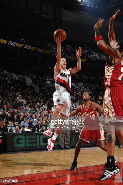 Sergio Rodriguez of the Portland Trail Blazers goes to the basket against Damon Jones of the Cleveland Cavaliers on January 17 2007 at the Rose...
