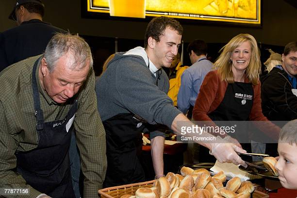 Sergio Rodriguez of the Portland Trail Blazers serves food during the team's 12th annual Harvest Dinner November 12 2007 at the Rose Garden Arena in...