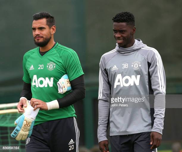 Sergio Romero and Axel Tuanzebe of Manchester United in action during a first team training session at Aon Training Complex on August 22 2017 in...
