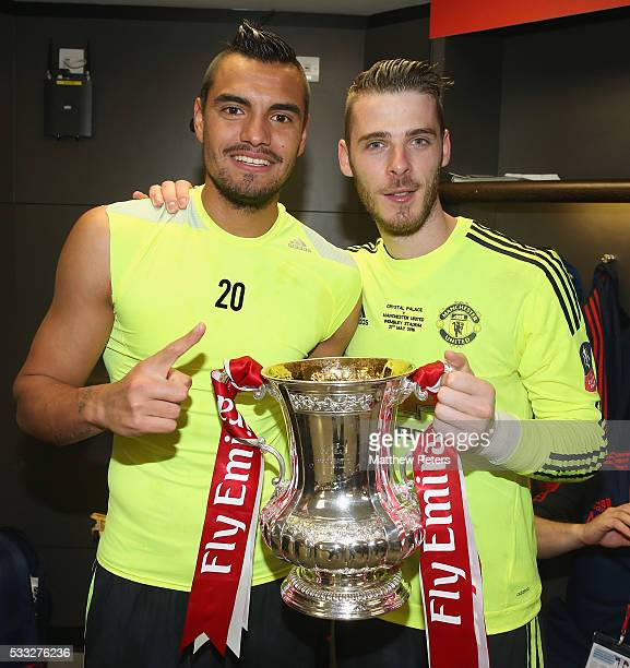Sergio Romero and David de Gea of Manchester United celebrate in the dressing room with the FA Cup trophy after The Emirates FA Cup final match...