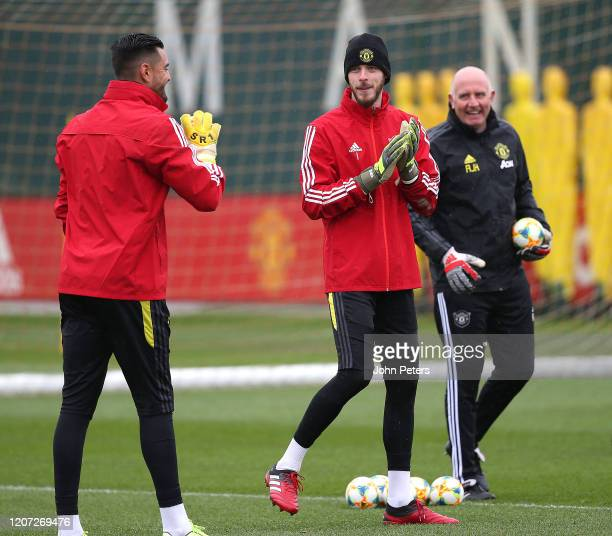 Sergio Romero and David de Gea of Manchester United in action during a first team training session at Aon Training Complex on February 19 2020 in...