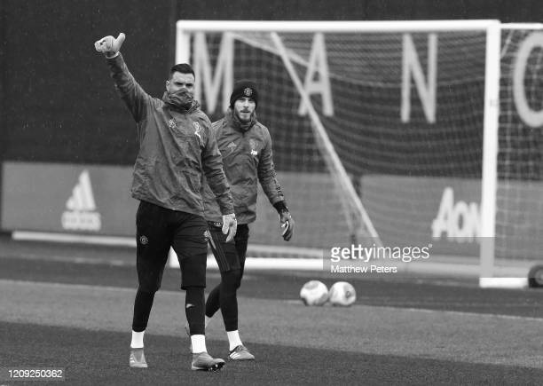 Sergio Romero and David de Gea of Manchester United in action during a first team training session at Aon Training Complex on February 28 2020 in...