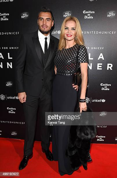 Sergio Romero and Eliana Guercio attend the United for UNICEF Gala Dinner at Old Trafford on November 29 2015 in Manchester England