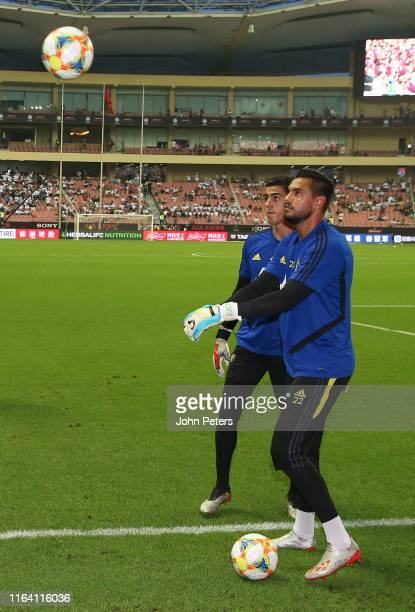 Sergio Romero and Joel Pereira of Manchester United warm up ahead of the International Champions Cup match between Tottenham Hotspur and Manchester...