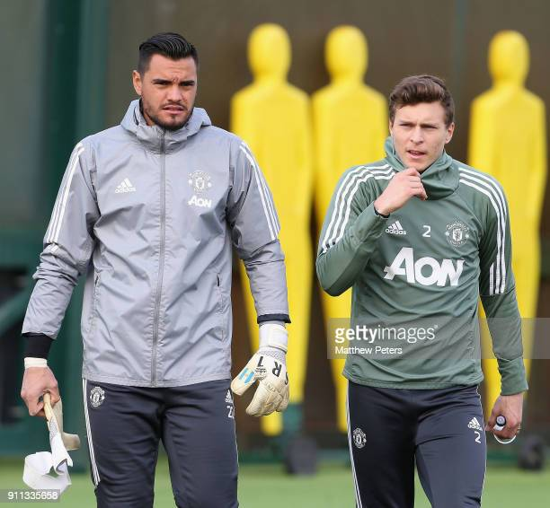 Sergio Romero and Victor Lindelof of Manchester United in action during a first team training session at Aon Training Complex on January 28 2018 in...