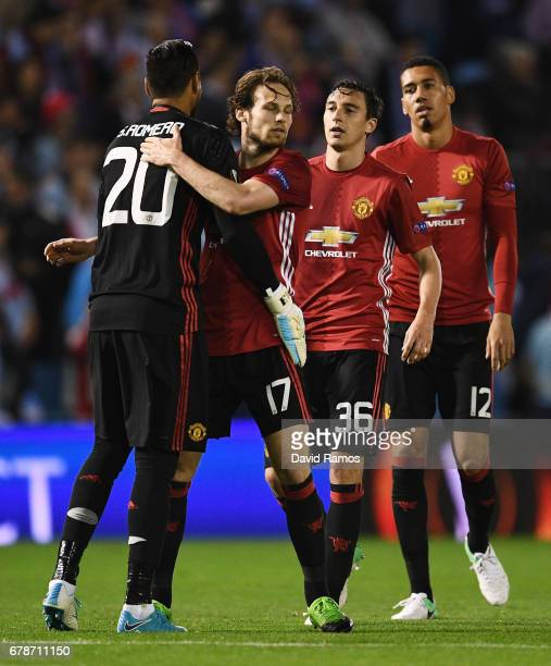 Sergio Romero Daley Blind Matteo Darmian and Chris Smalling of Manchester United celebrate victory after the UEFA Europa League semi final first leg...