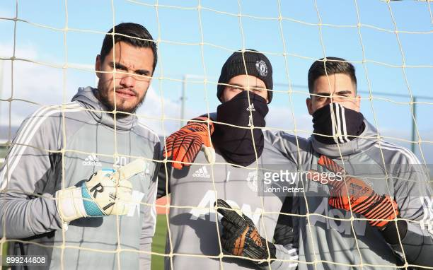 Sergio Romero, David de Gea and Joel Pereira of Manchester United in action during a first team training session at Aon Training Complex on December...