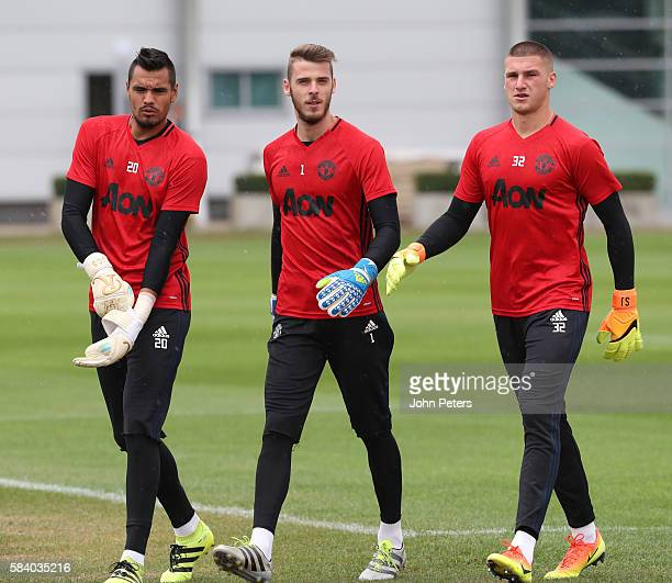 Sergio Romero David de Gea and Sam Johnstone of Manchester United in action during a first team training session at Aon Training Complex on July 28...