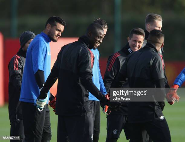 Sergio Romero Eric Bailly and Ander Herrera of Manchester United in action during a training session at Aon Training Complex on October 30 2017 in...