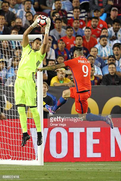 Sergio Romero goalkeeper of Argentina and Mauricio Pinilla of Chile jump for the ball during a group D match between Argentina and Chile at Levi's...