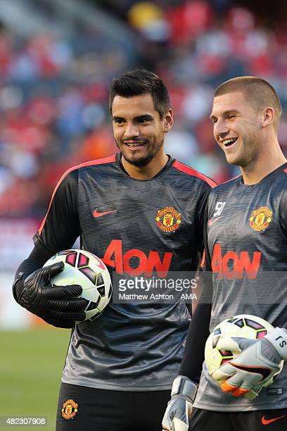 Sergio Romero goalkeeper of Manchester United warms up with Sam Johnstone before the International Champions Cup match between Manchester United and...