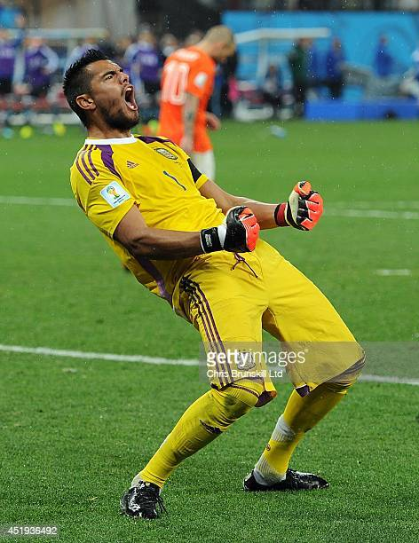 Sergio Romero of Argentina celebrates after saving the penalty of Wesley Sneijder of the Netherlands during the 2014 FIFA World Cup Brazil Semi Final...