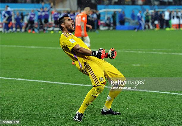 Sergio Romero of Argentina celebrates after saving the penalty of Wesley Sneijder of Holland