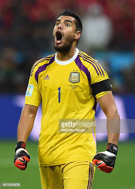 Sergio Romero of Argentina celebrates saving the penalty kick of Wesley Sneijder of the Netherlands in a shootout during the 2014 FIFA World Cup...