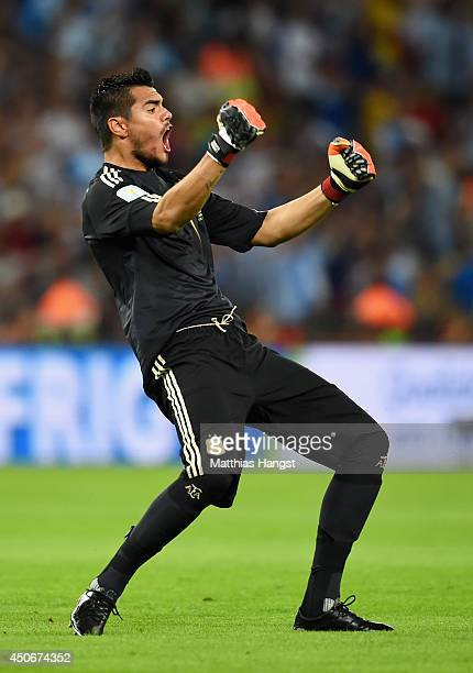 Sergio Romero of Argentina celebrates the team's first goal during the 2014 FIFA World Cup Brazil Group F match between Argentina and...