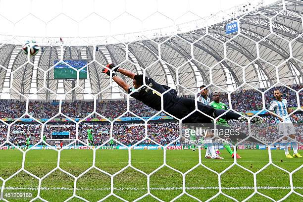 Sergio Romero of Argentina fails to stop the Nigeria's first goal scored by Ahmed Musa during the 2014 FIFA World Cup Brazil Group F match between...