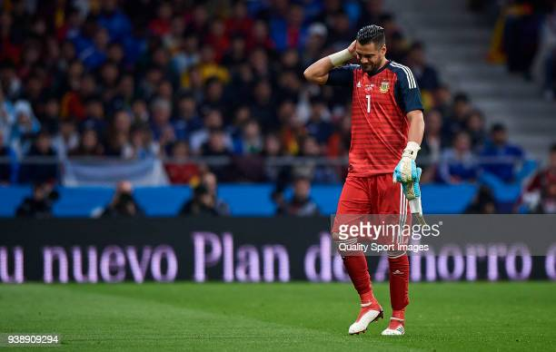 Sergio Romero of Argentina leaves injured the pitch during the International friendly match between Spain and Argentina at Metropolitano Stadium on...