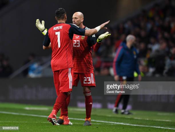 Sergio Romero of Argentina leaves the pitch due to injury as Willy Caballero of Argentina comes on in replacement during the International Friendly...