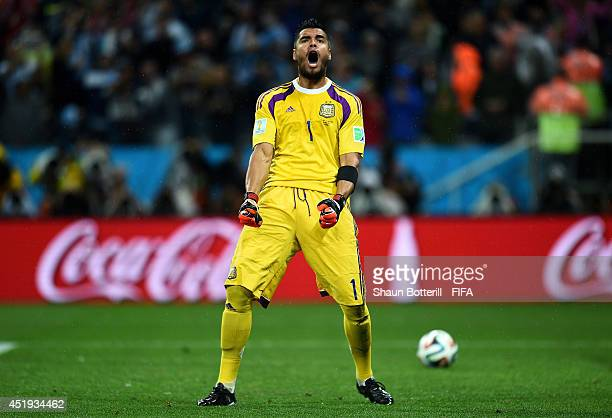 Sergio Romero of Argentina reacts after saving a penalty by Ron Vlaar of the Netherlands in the penalty shootout during the 2014 FIFA World Cup...