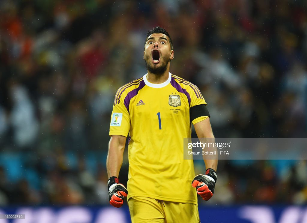 Sergio Romero of Argentina reacts after stopping the penalty kick by Wesley Sneijder of the Netherlands in the penalty shootout during the 2014 FIFA World Cup Brazil Semi Final match between Netherlands and Argentina at Arena de Sao Paulo on July 9, 2014 in Sao Paulo, Brazil.