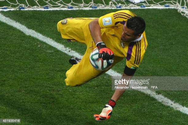 Sergio Romero of Argentina saves the penalty kick of Ron Vlaar in a shootout during the 2014 FIFA World Cup Brazil Semi Final match between the...