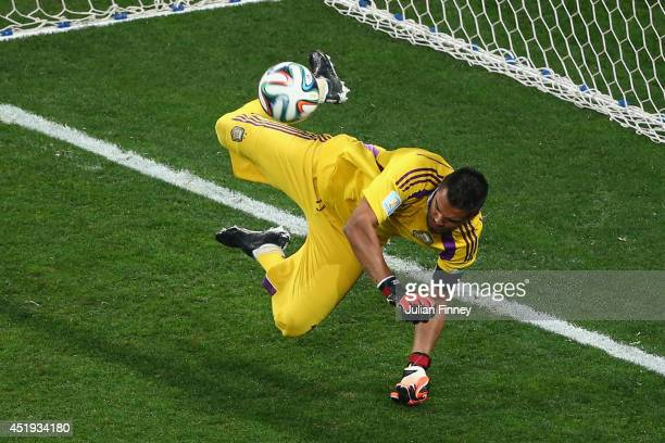 Sergio Romero of Argentina saves the penalty kick of Ron Vlaar of the Netherlands in a shootout during the 2014 FIFA World Cup Brazil Semi Final...