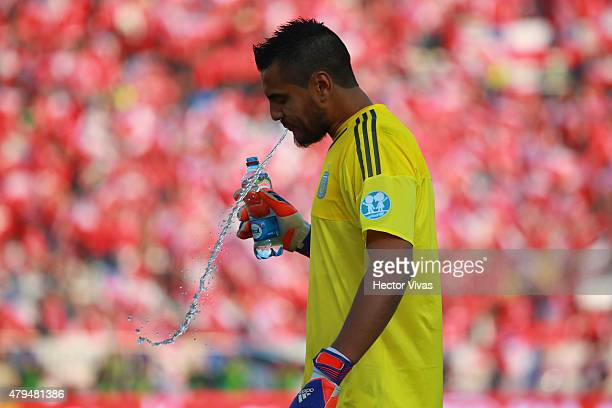 Sergio Romero of Argentina spits water during the 2015 Copa America Chile Final match between Chile and Argentina at Nacional Stadium on July 04 2015...