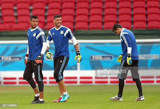 Sergio Romero of Argentina walks with Mariano Andujar and Agustin Orion during a training session at Estadio BeiraRio on June 24 2014 in Porto Alegre...