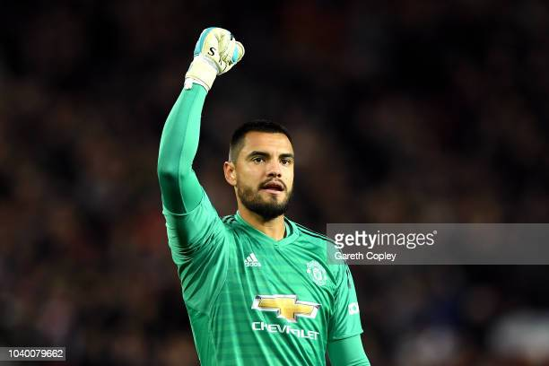 Sergio Romero of Manchester United celebrates his sides first goal during the Carabao Cup Third Round match between Manchester United and Derby...