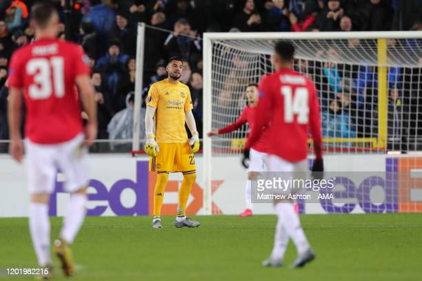 Sergio Romero of Manchester United dejected after Emmanuel Dennis of Club Brugge scored a goal to make it 10 during the UEFA Europa League Round of...