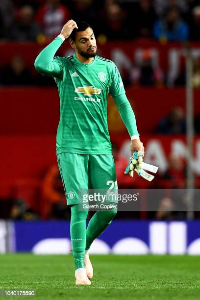 Sergio Romero of Manchester United looks dejected as he leaves the pitch after recieving a red card for a hand ball during the Carabao Cup Third...