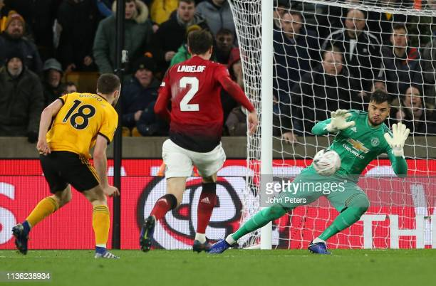Sergio Romero of Manchester United makes a shot from Diogo Jota of Wolverhampton Wanderers during the FA Cup Quarter Final match between...