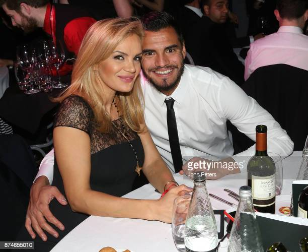 Sergio Romero of Manchester United poses with his partner Eliana Guercio at the annual United for UNICEF gala dinner at Old Trafford on November 15...