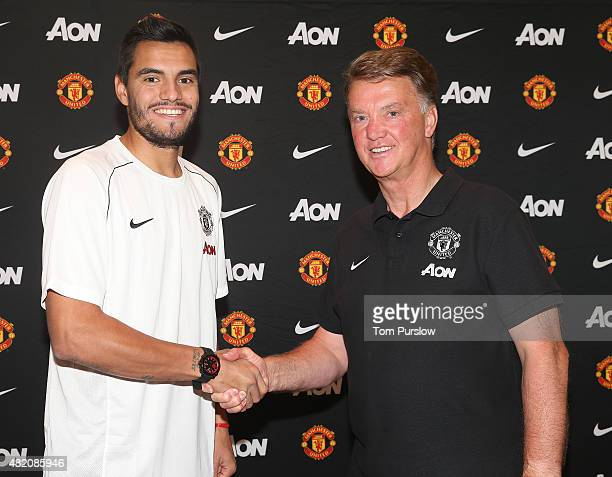 Sergio Romero of Manchester United poses with manager Louis van Gaal after signing for the club on July 26 2015 in San Jose California