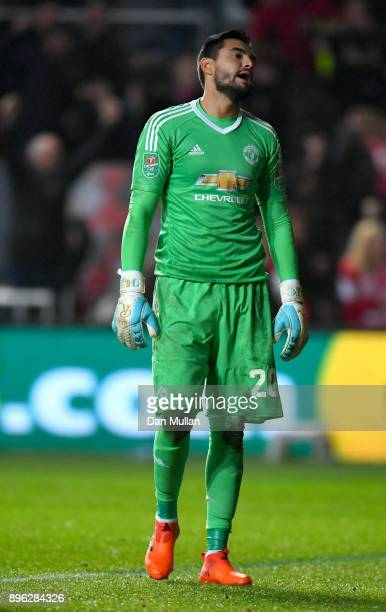 Sergio Romero of Manchester United reacts after conceding during the Carabao Cup QuarterFinal match between Bristol City and Manchester United at...