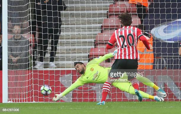 Sergio Romero of Manchester United saves a penalty from Manolo Gabbiani of Southampton during the Premier League match between Southampton and...