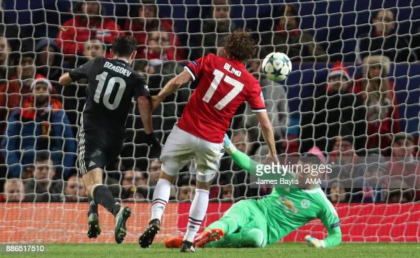 Sergio Romero of Manchester United saves from Alan Dzagoev of CSKA Moscow during the UEFA Champions League group A match between Manchester United...