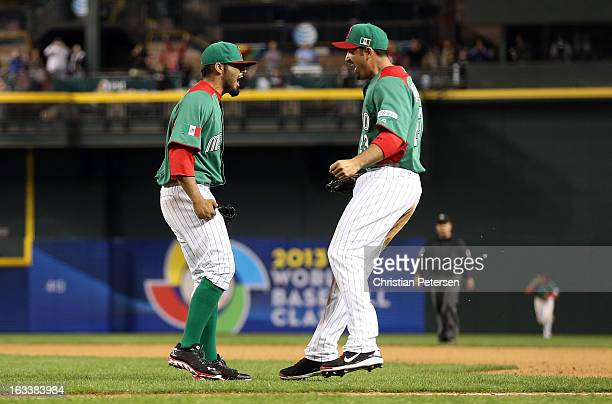 Sergio Romo and Adrian Gonzalez of Mexico celebrate after Mexico won 52 against the United States during the World Baseball Classic First Round Group...